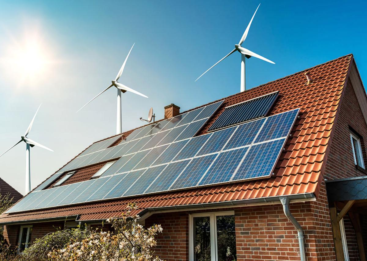 Sonnenkollektoren auf dem Dach von Haus- und Windturbinen – Konzept der nachhaltigen Ressourcen - Bild: @shutterstock|Diyana Dimitrova